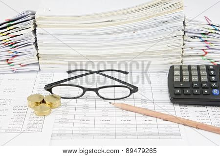 Brown Pencil With Black Spectacles And Gold Coins