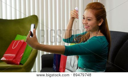 Latina Girl With Shopping Bags Taking Selfie With Phone