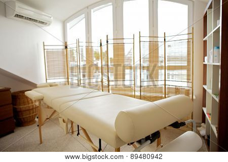 Empty massage table in room
