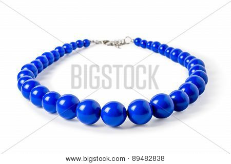 Blue Necklace Of Large Beads On A White Background