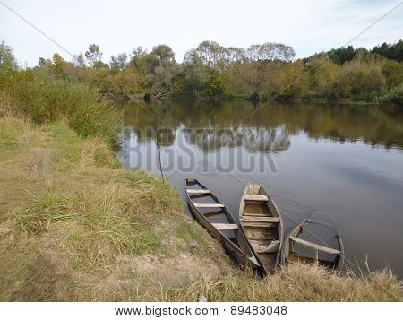 abandoned place - shore of river with old boats