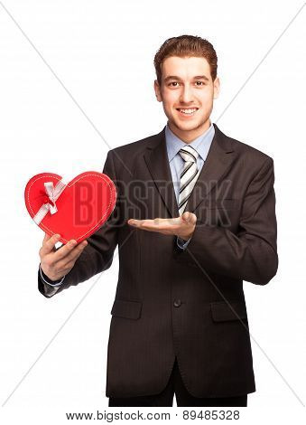 Businessman Showing A Heart-shaped Gift
