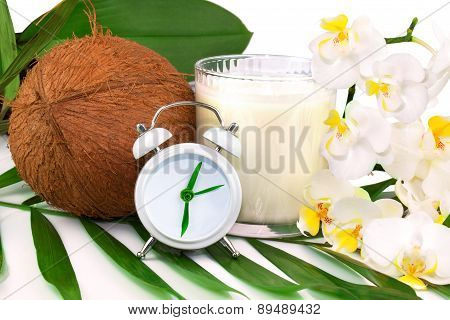 Spring Healthcare Concept With Coconut, Coco Milk, Flower And Clock