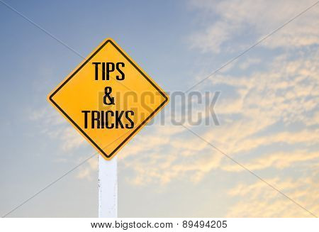 Road Sign Indicating Tips And Tricks On Blurred Sky Background