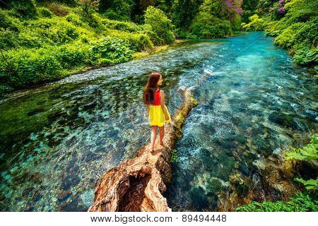 Girl walking on the river