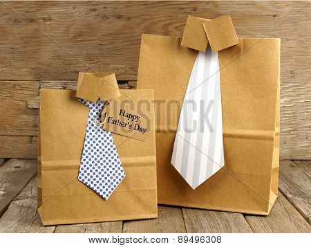 Fathers Day shirt and tie gift bags on a wood