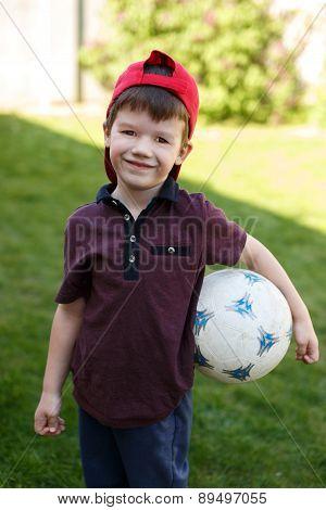Little Preschooler Boy With Soccer Ball
