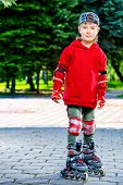 pic of 7-year-old  - Cool 7 year old boy rollerblades on the street - JPG