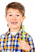 picture of tooth gap  - Little funny boy smiling at camera - JPG
