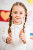 pic of pullovers  - Little pretty smiling girl in white pullover making thumbs up on colorful background - JPG