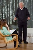foto of psychologist  - Psychologist listen to her patient at therapy session - JPG