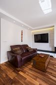 image of exclusive  - Comfortable leather sofa in exclusive living room - JPG