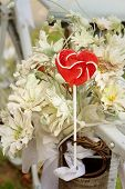 foto of valentine candy  - Candy valentines hearts on background of flowers - JPG
