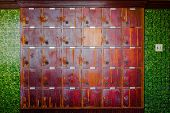 pic of woodcarving  - Old cherry wood locker in grungy retro looks - JPG