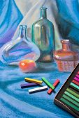 stock photo of pastel  - Artists chalk pastels and original pastel drawing of still life on the background - JPG
