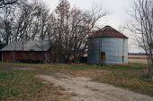 pic of illinois  - An old silo next to an old shed - JPG
