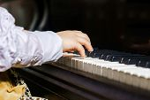 pic of grand piano  - Cute little girl playing grand piano in music school childhood concept - JPG
