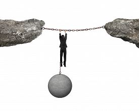 pic of ball chain  - Businessman shackled by heavy concrete ball hanging on iron chains connected two cliffs with white background - JPG