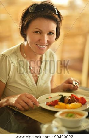 Woman eating at cafe