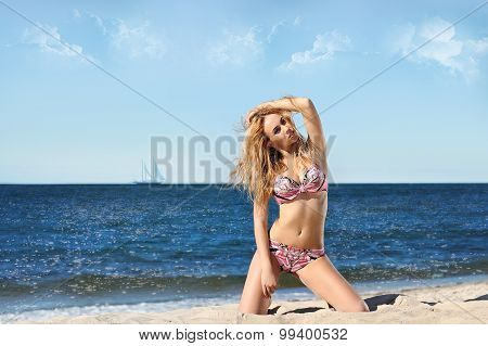 Portrait Of Happy Sexy Girl In Pink Bikini Posing Against Sea