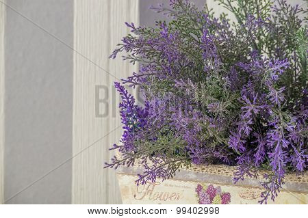 Synthetic lavender in a wooden box
