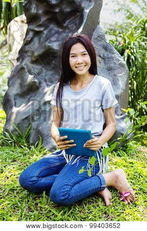 Portrait of young beautiful smiling asian girl with a plane table