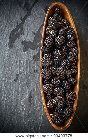 Fresh blackberries in wooden bowl