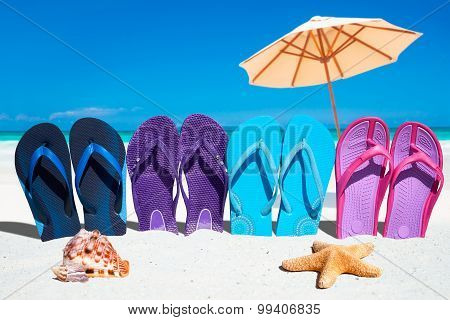 Colorful Flip Flops On The Beach