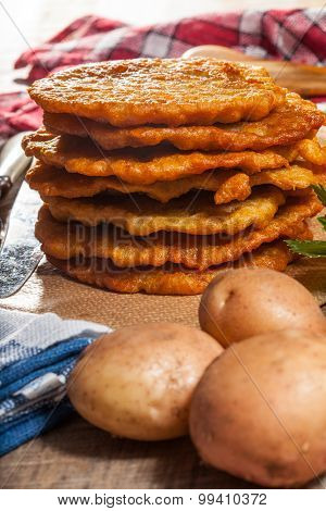 Potato Pancake On A Wooden Table.