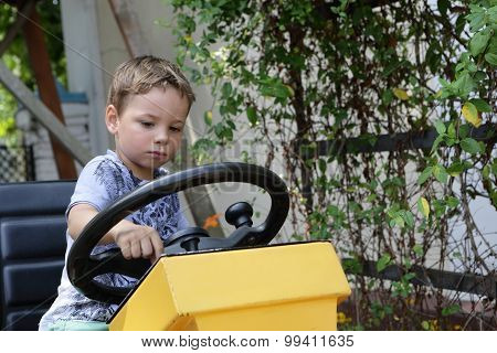 Kid Driving A Tractor