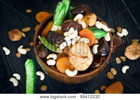 dried fruits in a wooden bowl