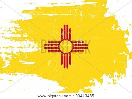 Scratched New Mexico Flag. A flag of New Mexico with a grunge texture