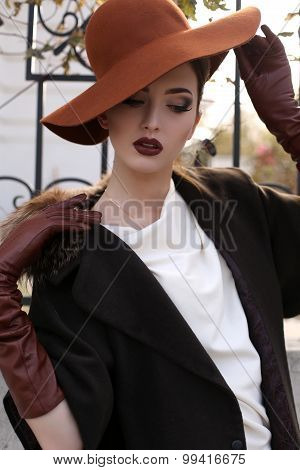 Beautiful Woman In Elegant Coat,gloves And Felt Hat