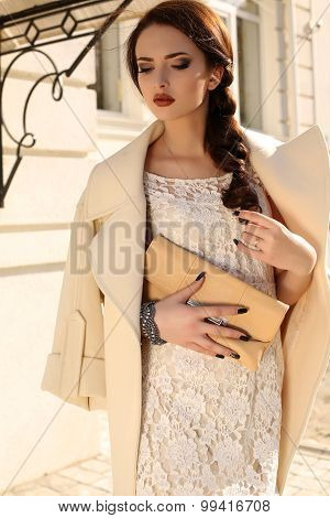 Beautiful Woman With Dark Hair In Elegant Beige Coat