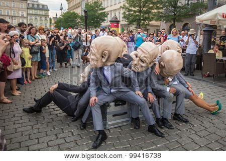 KRAKOW, POLAND - JUL 12, 2015: Participants at the annually (Jul 9-12) 28th International Festival of Street Theatres - Teatr KTO (PL) Peregrinus in Main Square and at random points around the city.