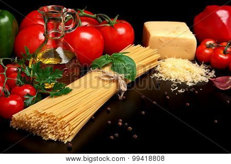 Pasta Raw Isolated On Black With Tomatoes,olive Oil,garlic