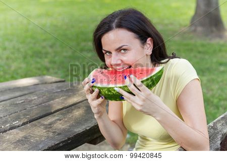 Smiling Young Woman Eating Watermelon