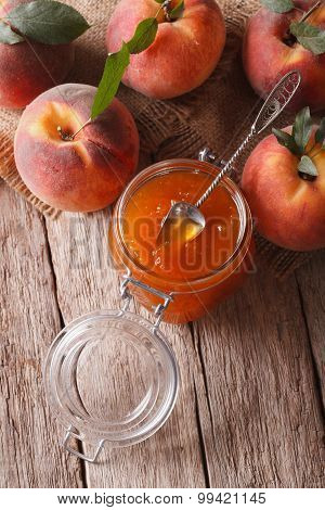 Fresh Peach Jam In A Glass Jar Close Up. Vertical Top View