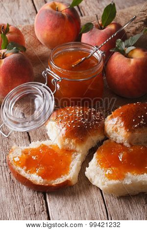 Homemade Buns With Peach Jam Close-up On The Table. Vertical