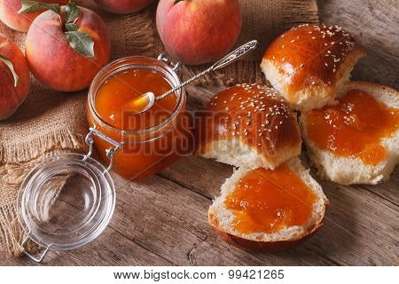Peach Jam And Sweet Buns Close-up On The Table. Horizontal