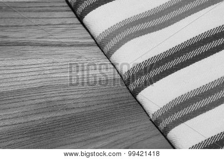 Black And White Photo Of Tablecloth (dishtowel) On Wooden Table