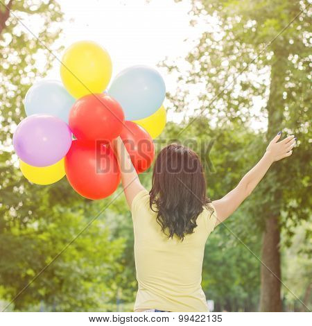Cheerful Young Woman With Colorful Balloons