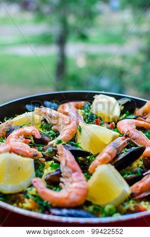 Close Up Classic Seafood Paella With Mussels, Shrimps And Vegetables In Frying Pan