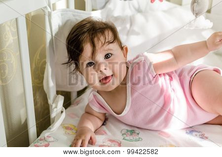 Cute Sweet Little Baby Girl Having Fun On Her Bed