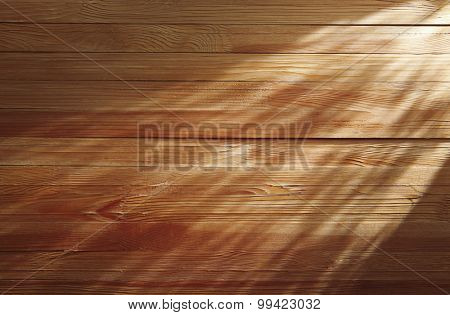 Light beam on wooden background