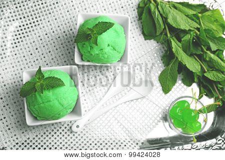 Homemade mint ice-cream on light wooden background