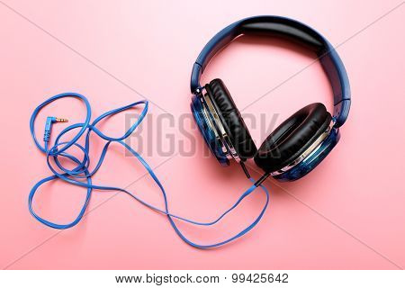 Headphones on pink background