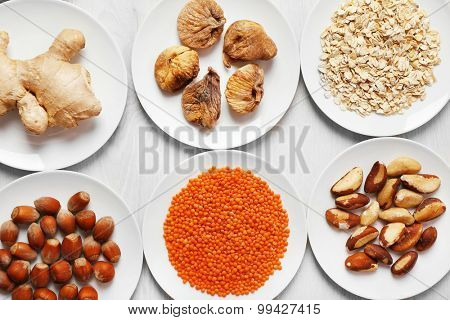 Set of different products on wooden table, closeup