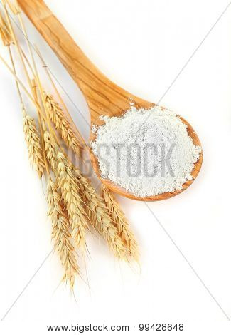 Wheat flour in wooden spoon isolated on white