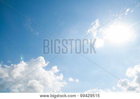 flare in blue sky and clouds